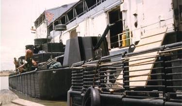 Dong Tam May 1967. Boats of RivRon-9 alongside YRBM-17.