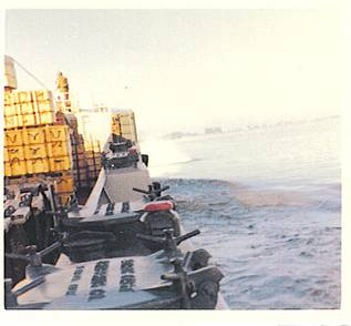 YFU-79 on entrance to Perfume River with grenade blast off starboard bow - 1969.