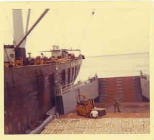 YFU-79 taking on ammo from Korean freighter in DaNang Harbor 1969