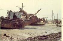 YFU-78 blown bow on DaNang Bridge Ramp after attack.