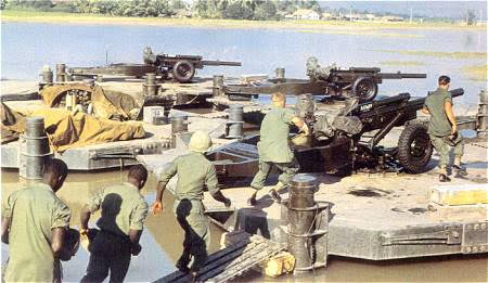 Artillerymen of the Army's 9th Infantry Division hurry to their pontoon-mounted guns for a fire mission in support of the MRF.